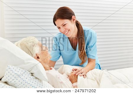 Caring Geriatric Nurse Image  Photo (Free Trial) Bigstock