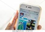 Apple IPhone Held In One Hand User Install Pokemon Go