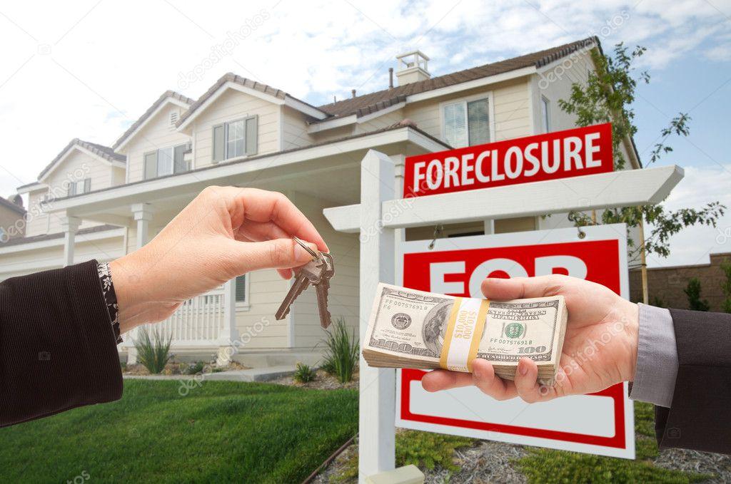 Handing Over Cash For House Keys â€