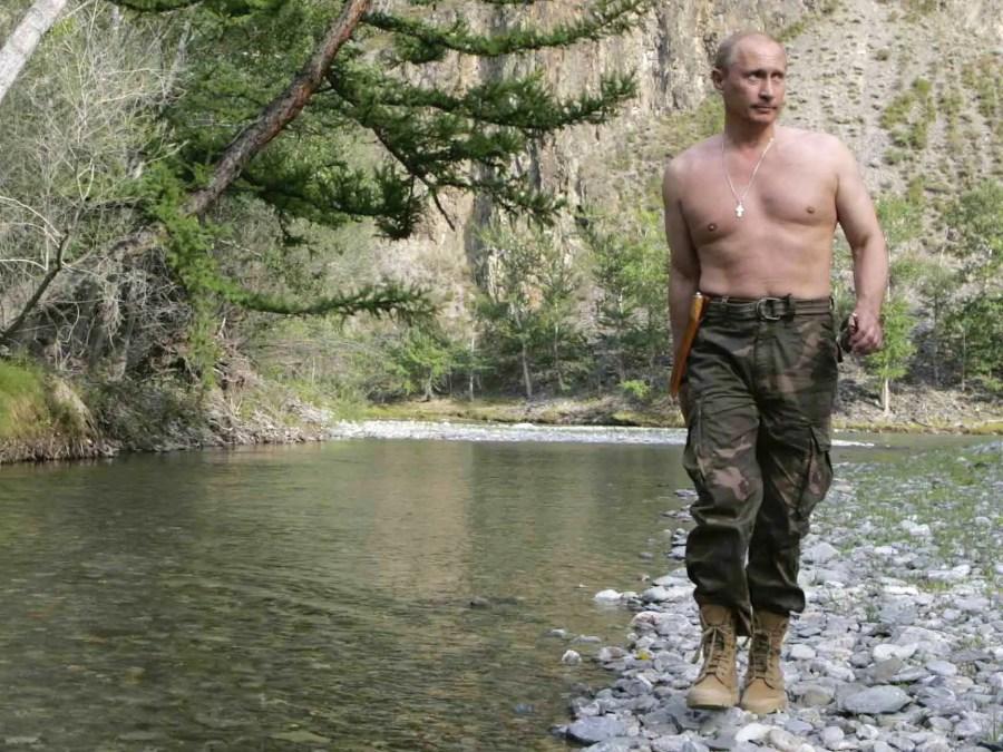 Vladimir Putin again eschews a shirt while hiking along the Siberian Khemchik River in the summer.