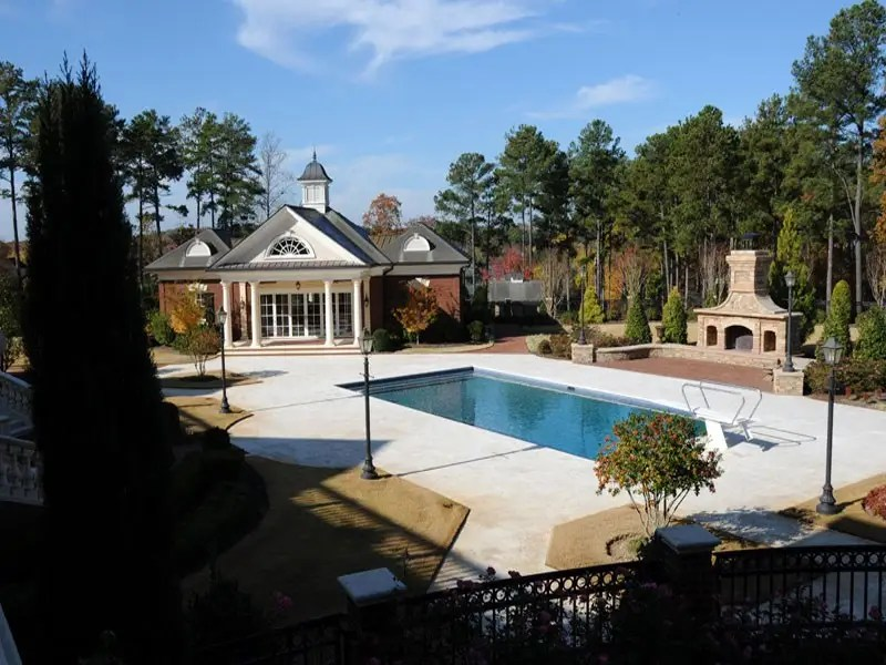 ... a saltwater pool! Complemented by an outdoor fireplace and landscaped pool area.