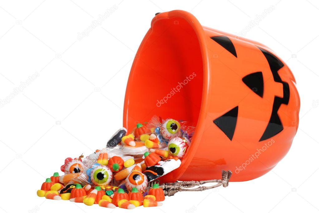 Child Halloween Pumpkin Bucket Spilling Candy Stock