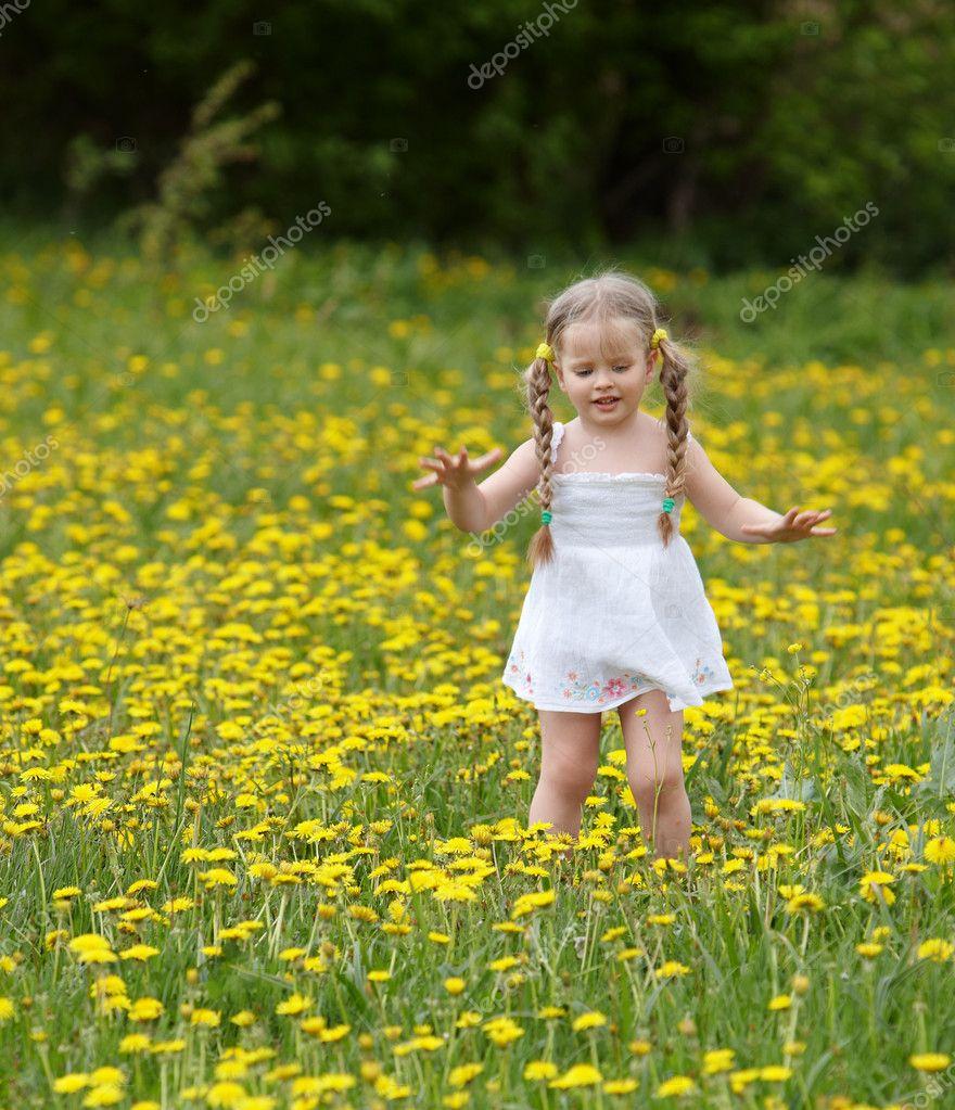 Cute Little Girl In Rain Wallpaper Little Girl On Grass In Flower Stock Photo 169 Poznyakov
