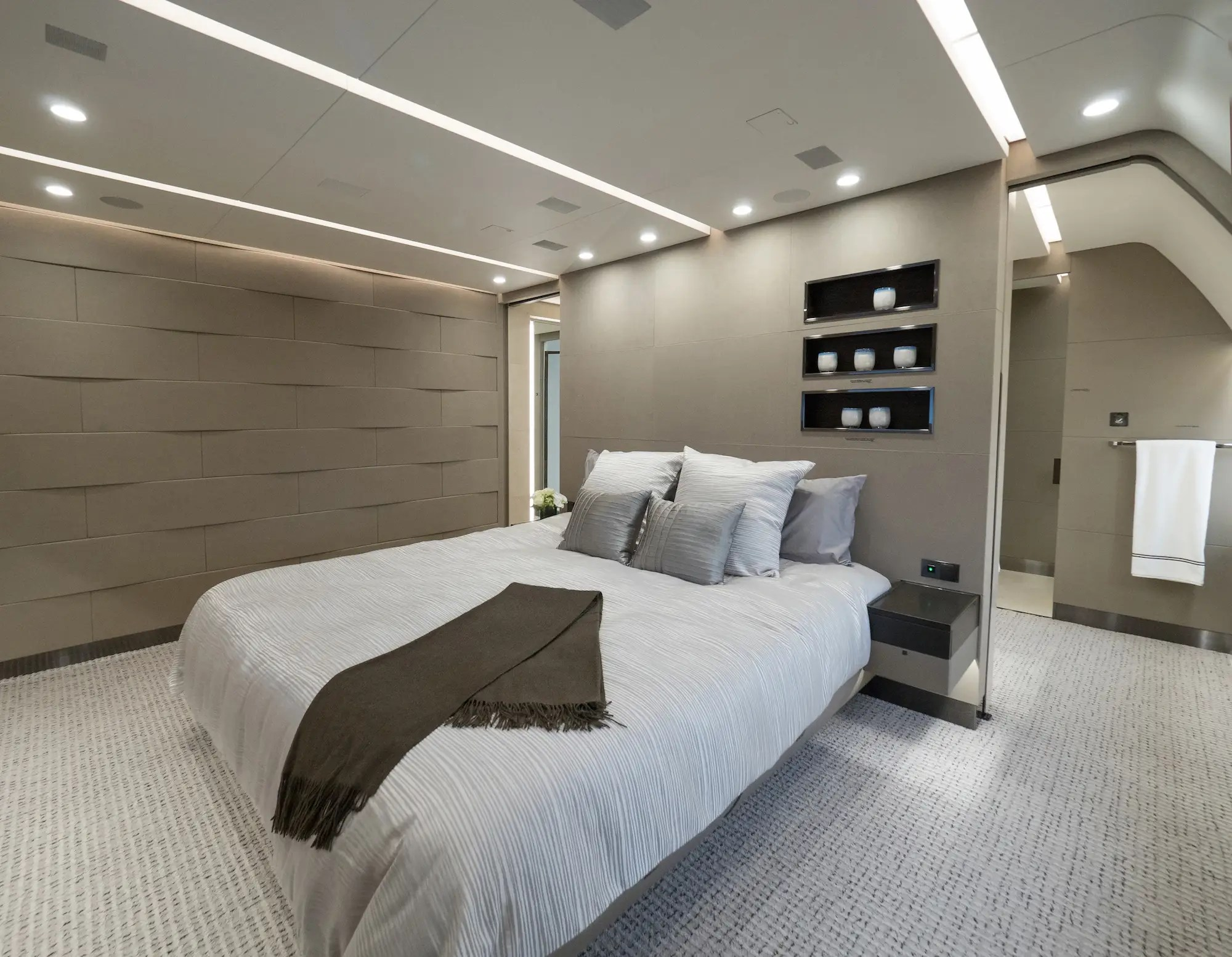 Enter the plane through its round foyer and you'll immediately encounter the doors to its massive master suite. The suite is divided in several sections and is designed to be totally independent from the rest of the plane.