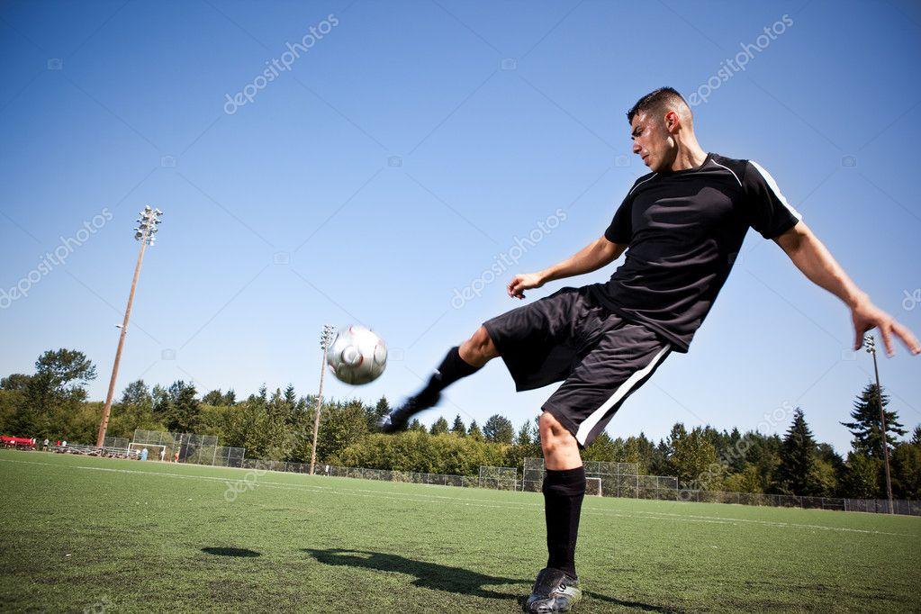 Boy Kick Girl Wallpaper Hispanic Soccer Or Football Player Kicking A Ball Stock