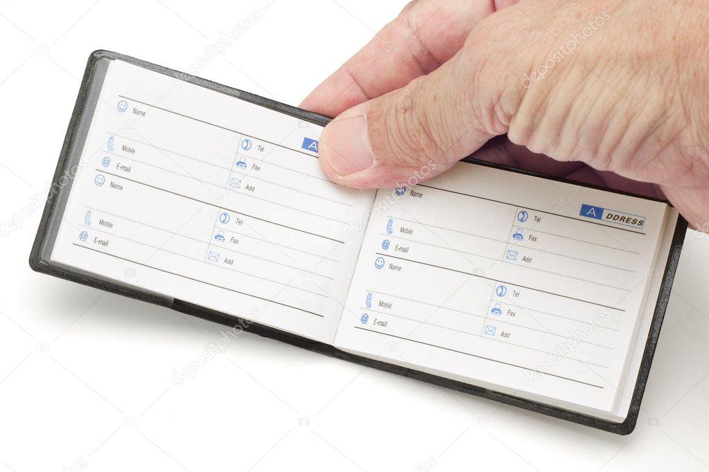 Hand holding mini address book \u2014 Stock Photo © design56 #6138012