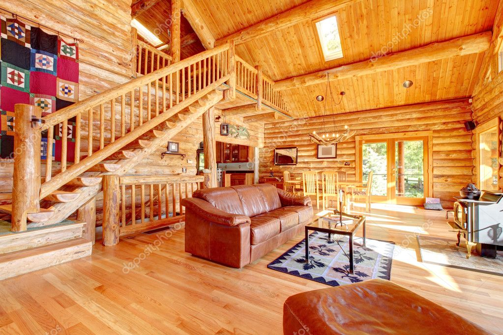 Luxury log cabin living room with leather sofa u2014 Stock Photo - log cabin living rooms