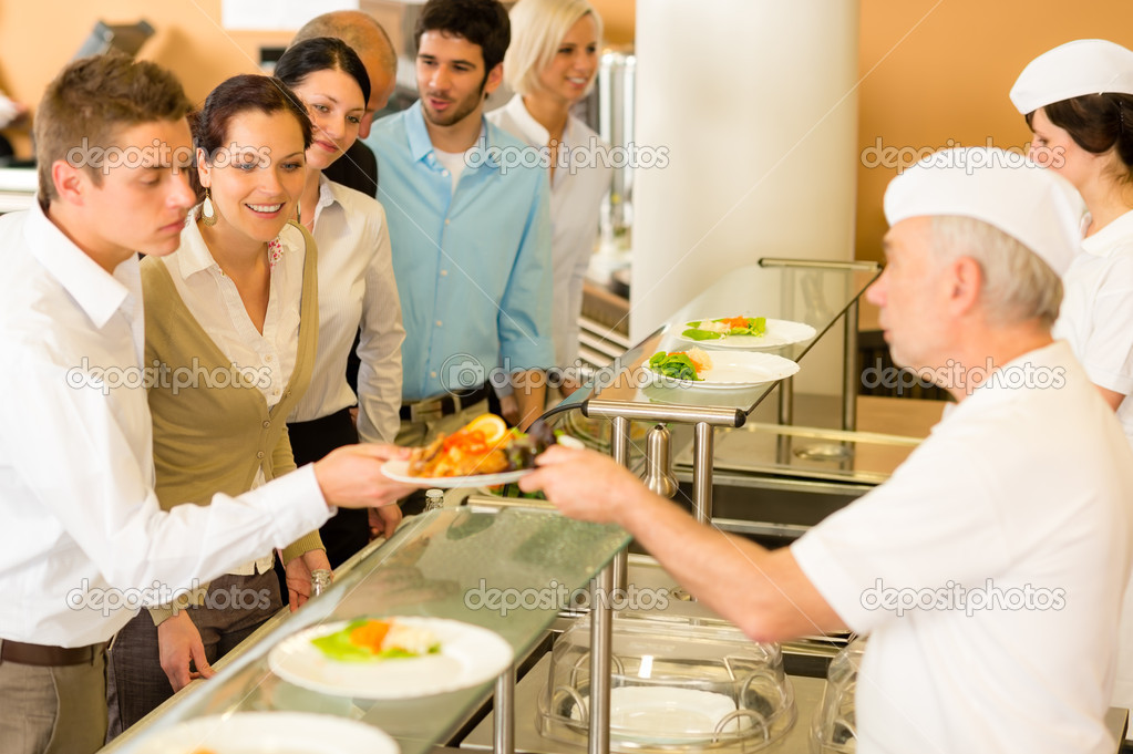 Office colleagues in canteen cook serve meals \u2014 Stock Photo