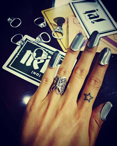 Star Outline Finger Tattoo Idea