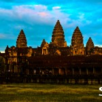 Golden glow of the sunset on the lotus-like towers of Angkor Wat