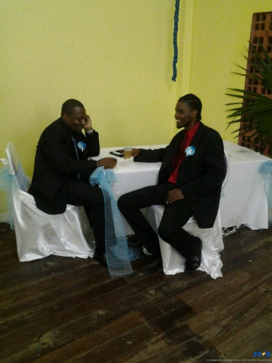 Kendal Emmanuel (L), President of the Mabouya Youth and Sports Council and Ryan James (R) Coordinator of the council, having a drink after a successful awards ceremony.