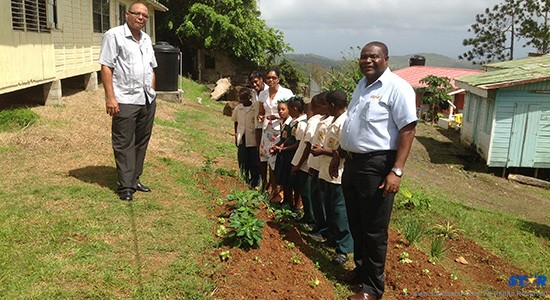 IICA rep and perishables manager of CFL Dunstan Demille with students and staff at La Guerre Primary School.