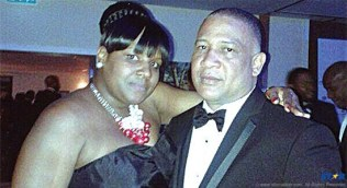 There's no mistaking Saint Lucia's mission head in the UK, Ernest Hilaire. But who is that woman snaked around him?