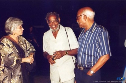 Hunter J. Francois (center) has left the building.Pictured with friends on his way to a Derek Walcott opening.