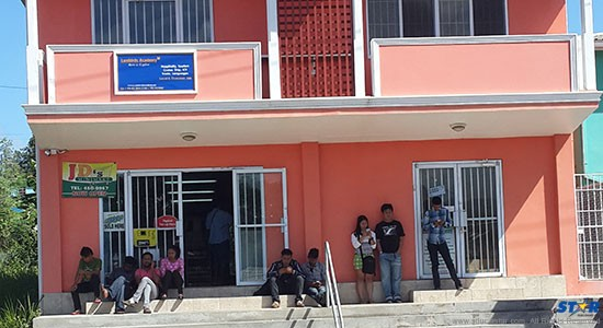 Yesterday (Friday March 6) stranded students waited outside the Lambirds building in Gros Islet for the police who promised to take further statements from them as well as locate suitable boarding for some.