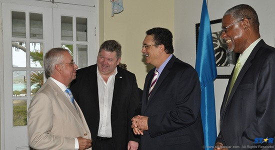 Saint Lucia Country Manager Randy Cato (right) and Prime Minister Kenny Anthony (second from right) meet with members of the British Chamber.