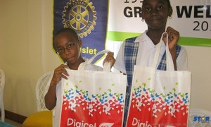 Grow Well - Nathan Sherman and Letana Bruneau of the Montessori Centre receiving their handsets.