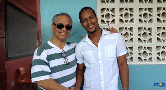 Wayne with teacher, poet and author Stephen Dantes. He invited the publisher to address his students at their behest.
