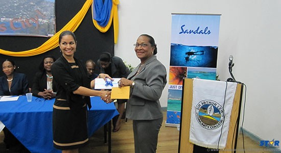 Marella Devaux, Group Marketing Manager handing over donation to Fortuna Anthony, Chairperson of the Sir Arthur Lewis Community College Board.