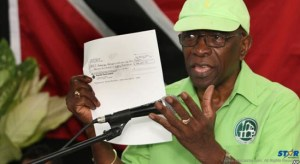 Former FIFA Vice President Jack Warner holds a copy of a cheque while he speaks at a political rally in Marabella, Trinidad and Tobago, June 3, 2015.