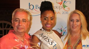 John Kennedy, Chairman of the Boka Group, and his wife, Dragana Kennedy, presenting a bouquet to Miss Boka,  Kadijha Mason.