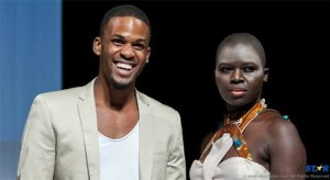 Kadeem Faustin (left) with a model wearing one of his designs.