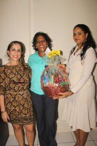 In this photo Michelle accepts a token of appreciation from STAR Publishing Managing Director Mae Wayne (left) and Marcia Charles (right).