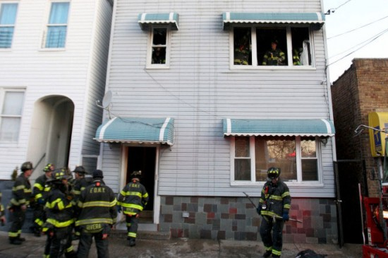 Firefighters investigate the firescene in the Bronx.
