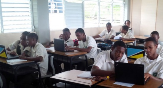 Secondary school students using laptops donated as part of the  government's schools laptop programme.