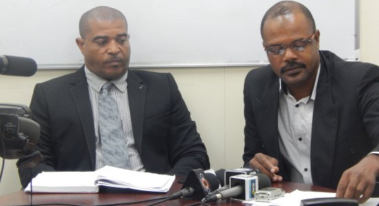 L-R: Officer in Charge Of Crime Management, Mr. Milton Desir, and Superintendent of Crime Management, George Nicholas.