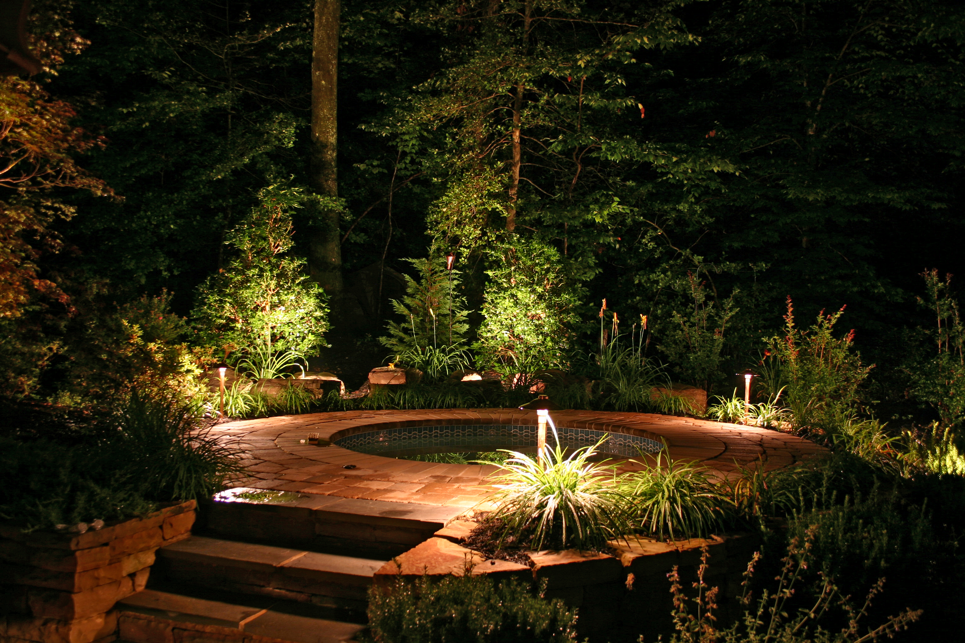 Low Voltage Led Outdoor Lighting Systems Pool-and-jacuzzi-steps-propery-lit-by-outdoor-lighting