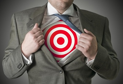 A businessman pulling back his skirt to reveal a target symbol.