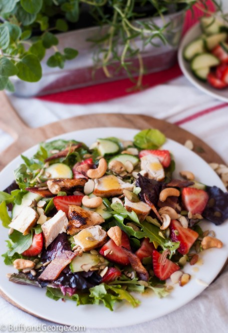 A filling summer salad with grilled chicken, bacon, cashews, sliced almonds, pumpkin and sunflower seeds. It is dressed with a Chipotle Lime Vinaigrette.