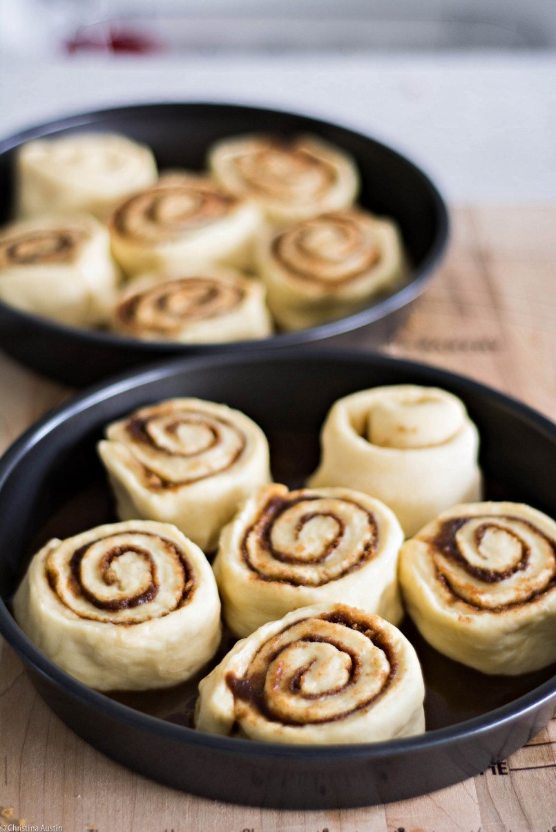 Unbaked cinnamon buns in two pans