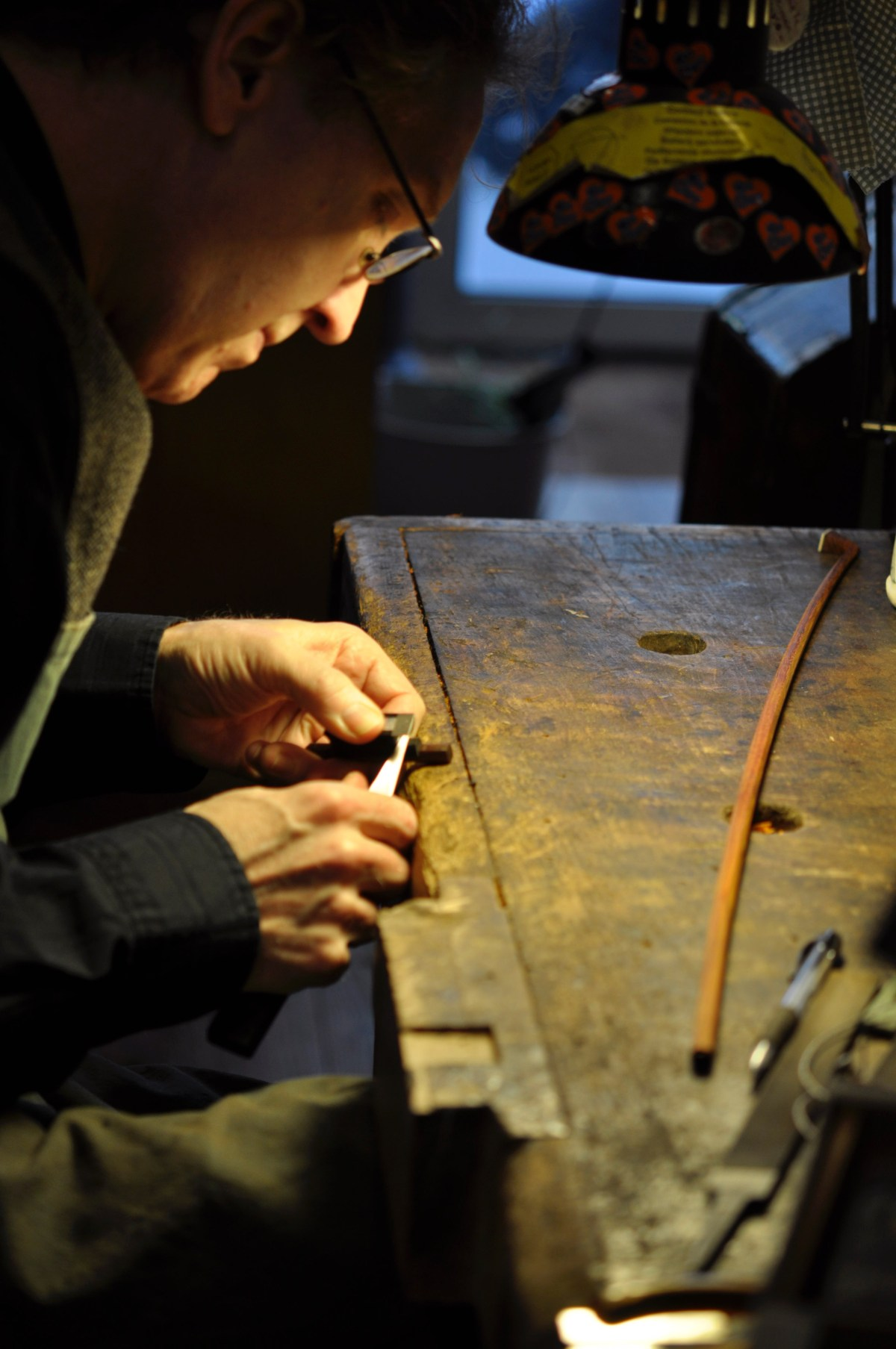 Bow maker Matt Wehling working in Paris in the L'Atelier D'Arthur shop.