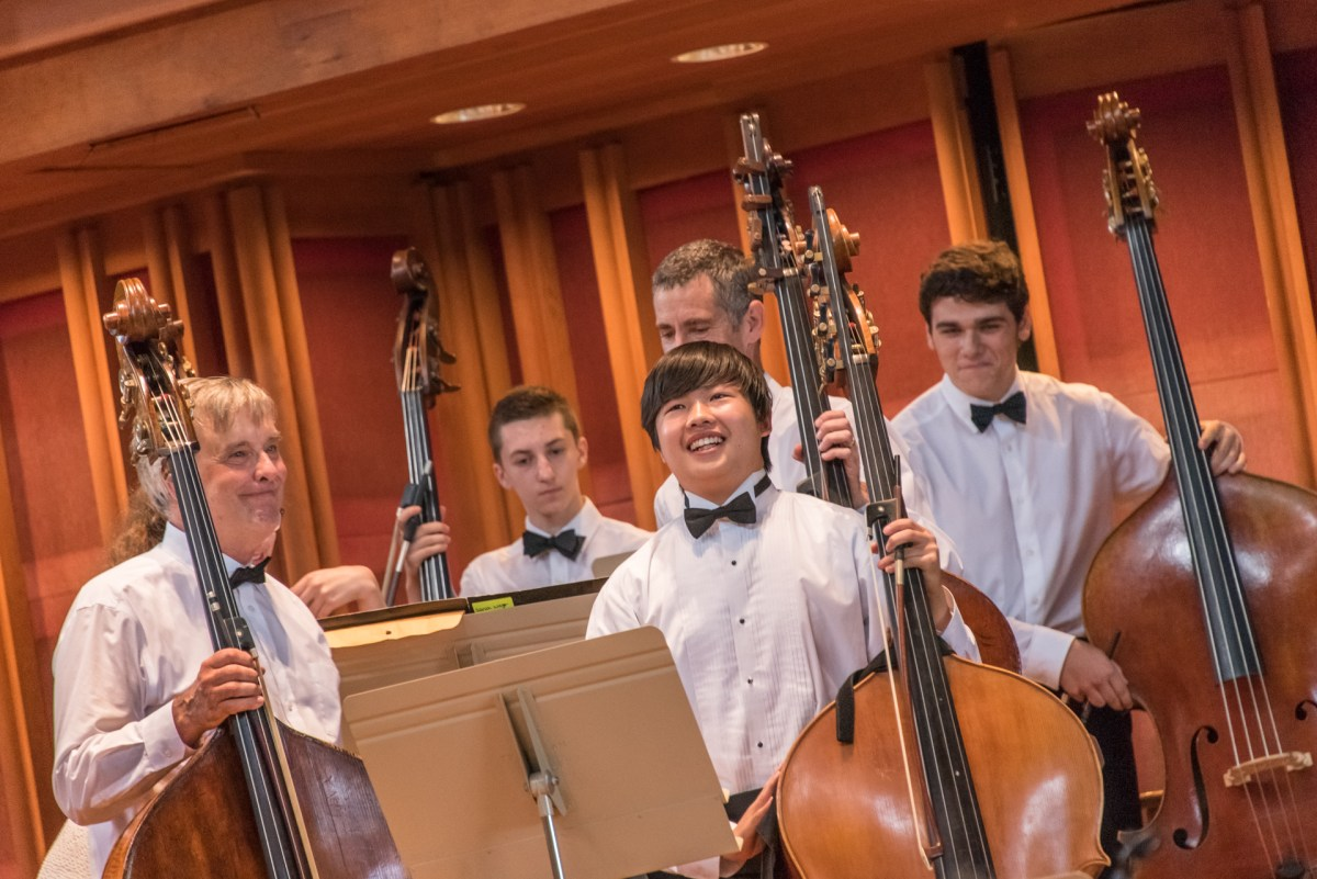 BUTI alum and BSO bassist Lawrence Wolfe with double bass BUTI students. Photo Stratton McCrady Photography