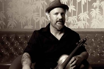 Violinist David Bragger with his fiddle