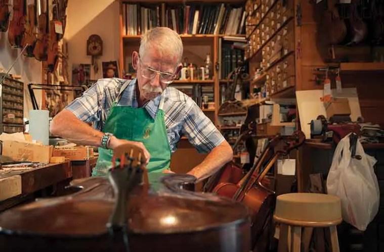 Luthier Hans Benning works at Benning Violins, one of L.A.'s celebrated shops