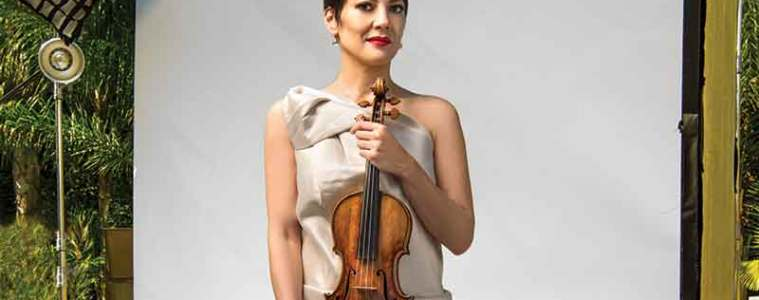 Anne Akiko Meyers poses with her 1741 'Vieuxtemps' Guarneri del Gesu