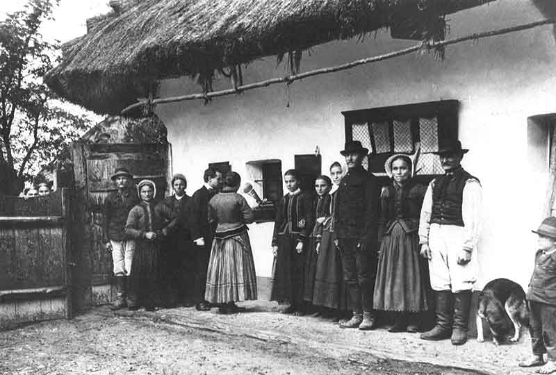 Composer and ethnomusicologist Béla Bartók using a gramophone to record folk songs sung by Slovak peasants in 1908. Photo courtesy of the Bartók Archives