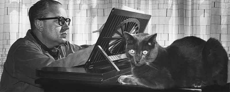 Argentine composer Alberto Ginastera at the piano with his cat