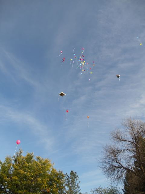Prayer balloons floating away Stronghold Society