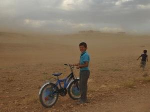 Spotty boy in sand storm