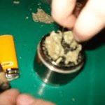 marijuana in a grinder and some blunts