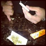 rolling up joints with zig zag orange papers