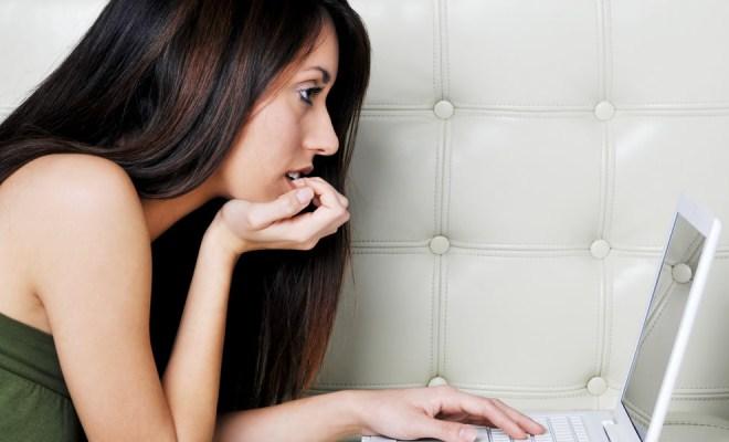brunette-looking-at-laptop
