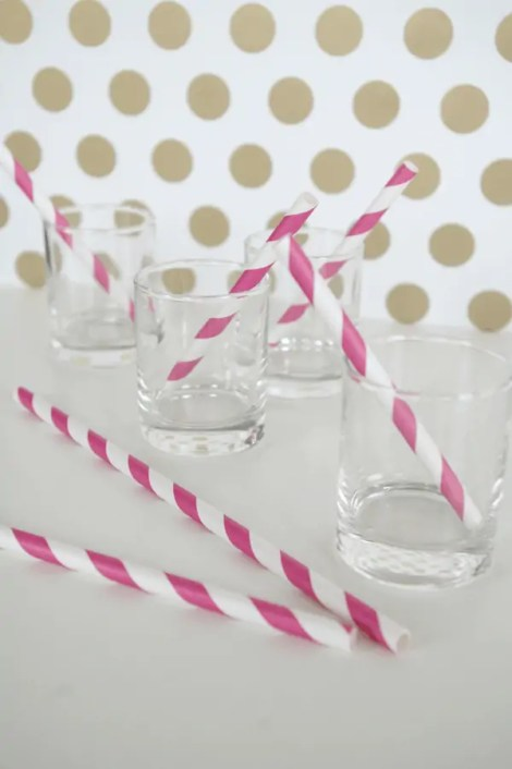 Salted Caramel Ice Cream Cake Shots with pink striped straws