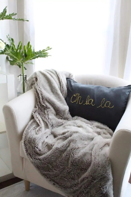 "DIY gold foiled ""oh la la"" pillow"