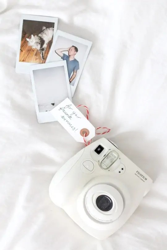 a polaroid mini camera is a way to welcome guests for the holidays