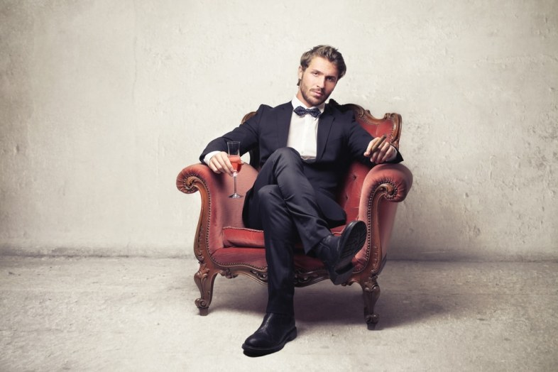 alpha male in a suit sitting down